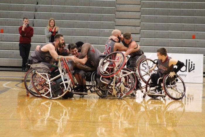 The Alabama Mens Wheelchair Basketball team embrace each other after winning the 2017-2018 National Championship.