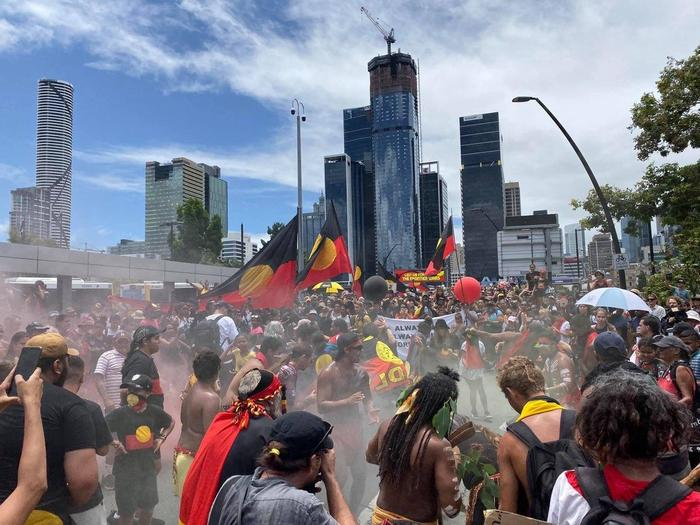 Protestors chanted as they crossed the bridge over to South Brisbane heading towards Musgrave Park
