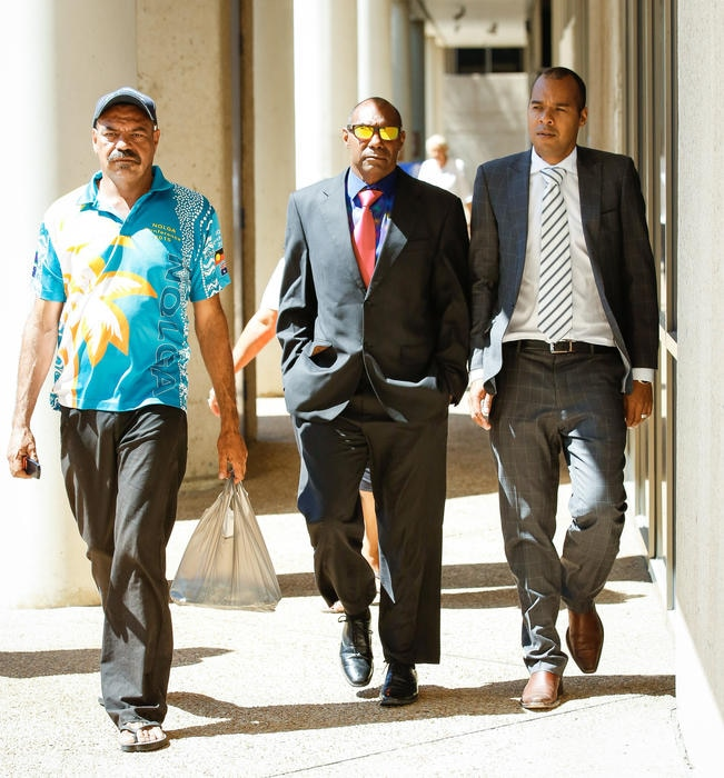 Lex Wotton (centre) his brother Anthony Wotton, (left) and his barrister Josh Creamer arriving at the Federal Circuit Court in Townsville to give evidence.