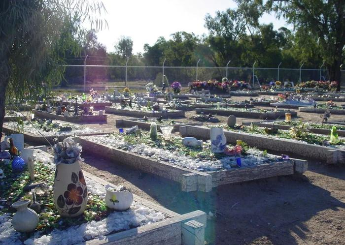 Decorated graves at the Collarenebri cemetery.