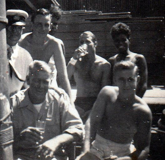 The crew of Coweambah with Farry and Tiger with a harbor officer.