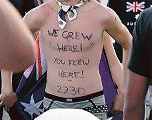 Protester wearing 2230 postcode for Cronulla.