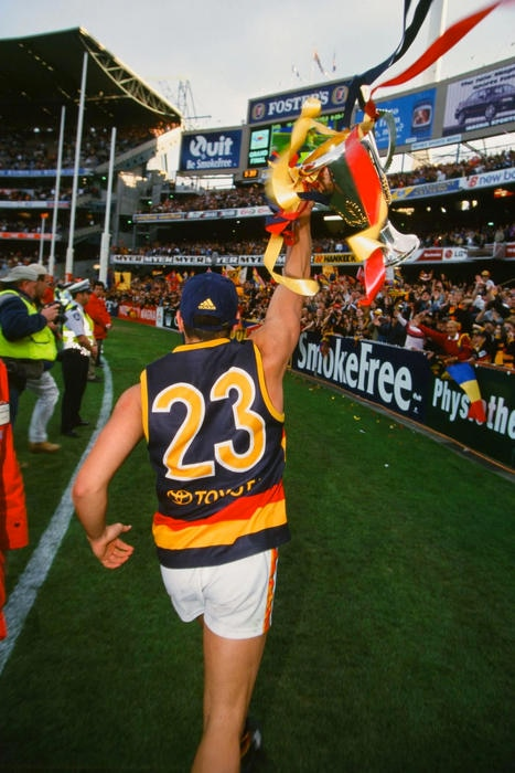 Andrew McLeod holds up the 1998 premiership cup. Picture AFL Photos