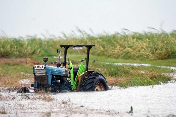 A tractor is seen inundated with water on a property south of Bowen after Cyclone Debbie