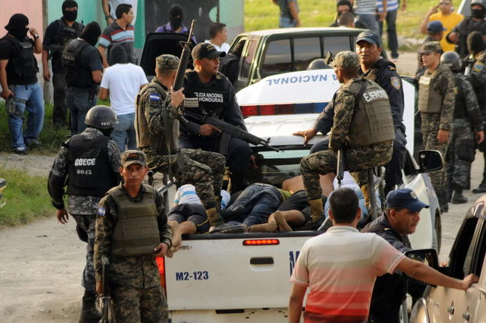 Police arrest gang members after a firefight in San Pedro Sula, Honduras.