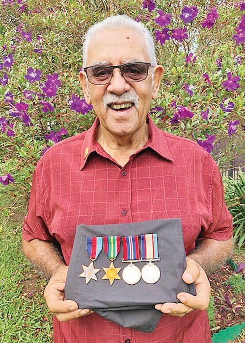 Edgar Williams Jnr with his father's service medals.