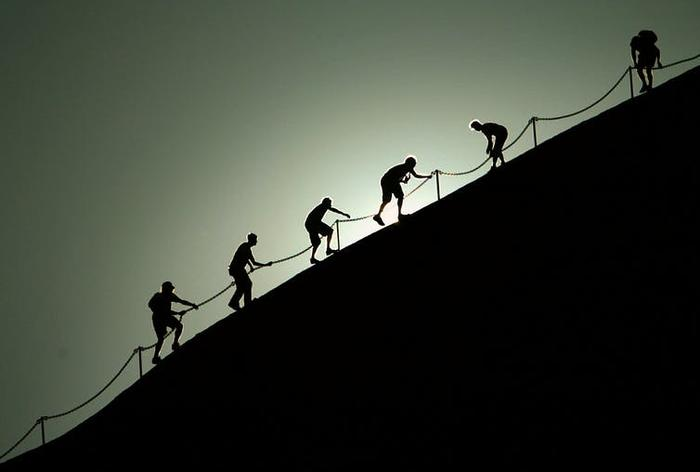 Tourists have previously used a chain to climb Uluru.