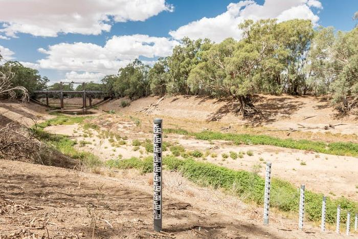 Exposed water height markers on the Darling River reveal the depth of the crisis at Wilcannia. John Janson-Moore