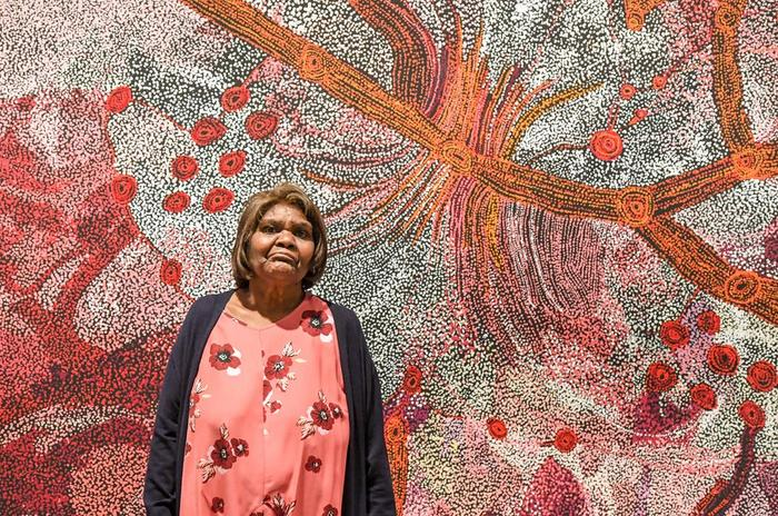 Sylvia Ken, winner of the 2019 Wynne Prize, with her painting of the Seven Sisters at the Art Gallery of NSW in May. Peter Rae/AAP