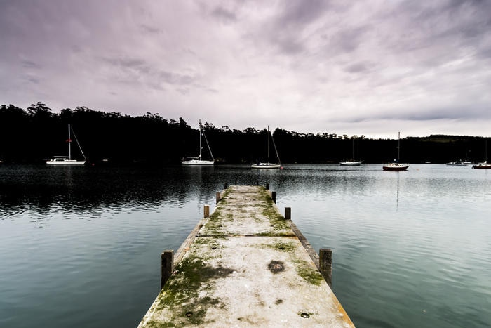 Concrete Jetty with Sailing Yachts in the Background