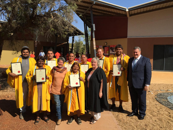 Batchelor Institute graduates with their lecturers and Alice Springs Mayor Damien Ryan (right).