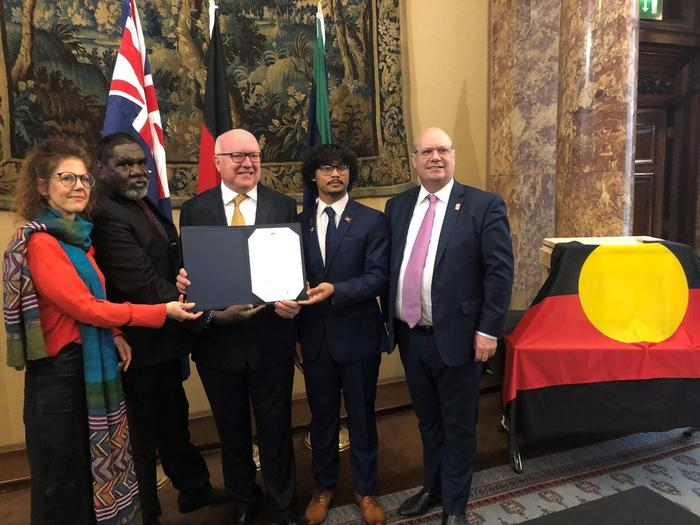 The official handback at Australia House with the Australian High Commissioner George Brandis and Manchester Museum Director Esme Ward, CEO of AIATSIS Craig Ritchie.