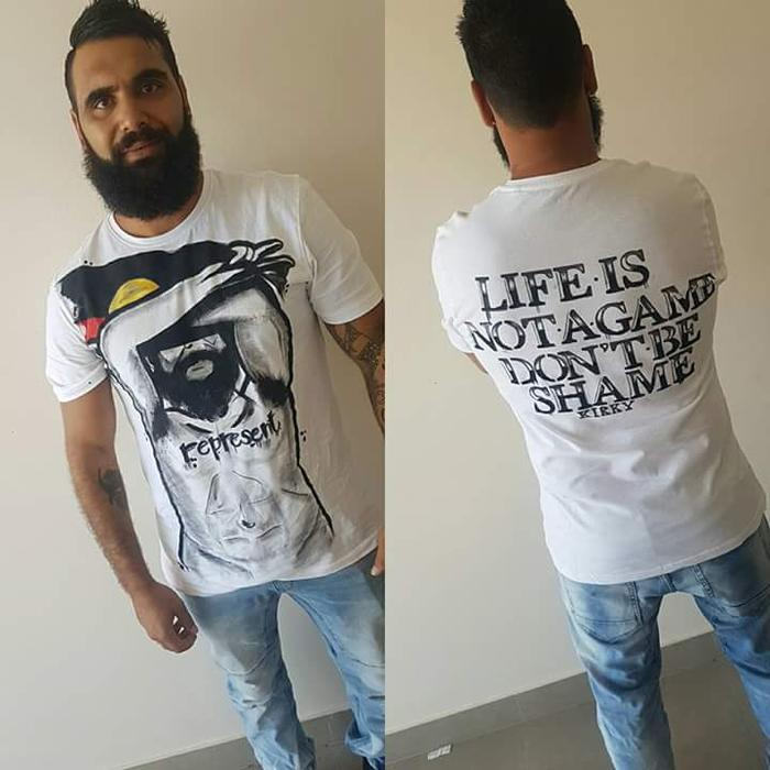 """Indigenous youth worker Josh Kirk wearing t-shirts to break down the """"shame"""" associated with suicide."""