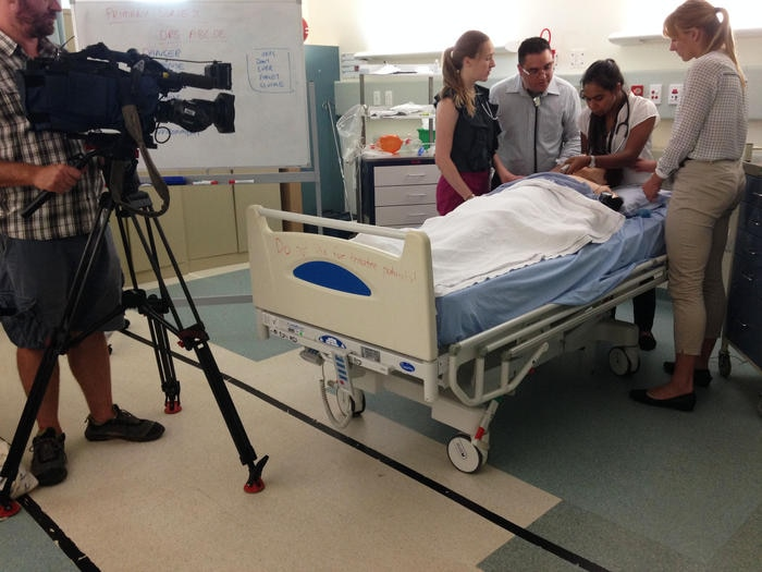 Dr Isaac Hohaia shows Vinka and two other medical students how to react in an emergency.