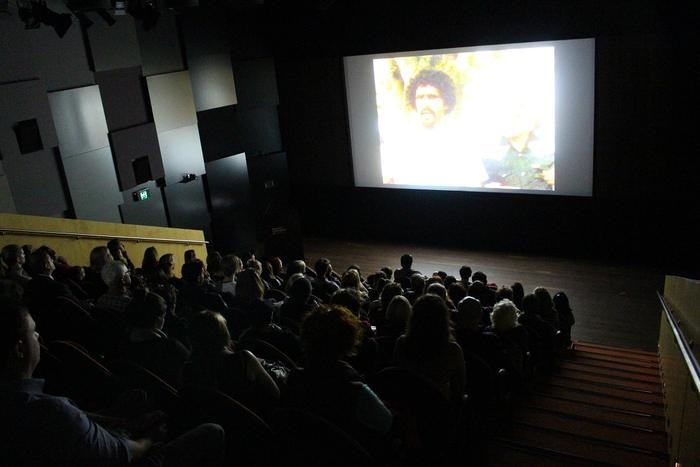 A captured audience watches 'WE FIGHT' at the Museum of Contemporary Art, Sydney, 2018.