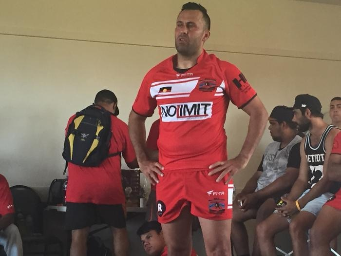 Matt Rose of Walgett Aboriginal Connection speaks to the team following their loss to Griffith 3 Ways United in round 2 of the 2015 Koori Knockout.