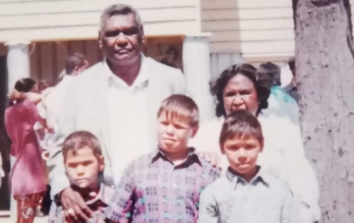 Keenan Mundine with his brothers and grandparents