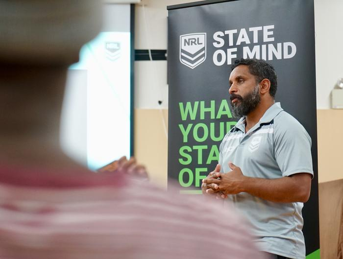 Preston Campbell speaking in front of the NRL's State of Mind corflute