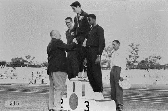 Percy Hobson receiving gold after winning the high jump at the Commonwealth games 1962.