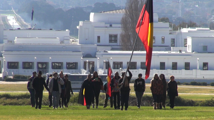 Crowd marching up to Tent Embassy