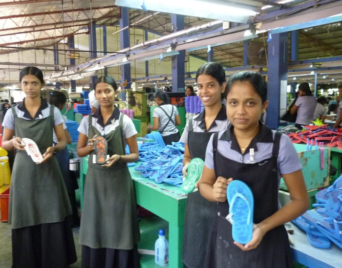 Employees making thongs in Etiko's fair trade factory in India.