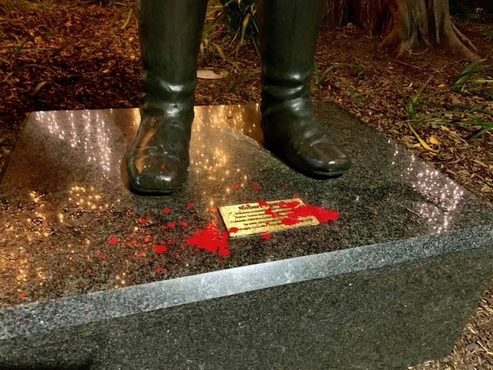 Red paint droplets between the feet of the Robert Towns statue.