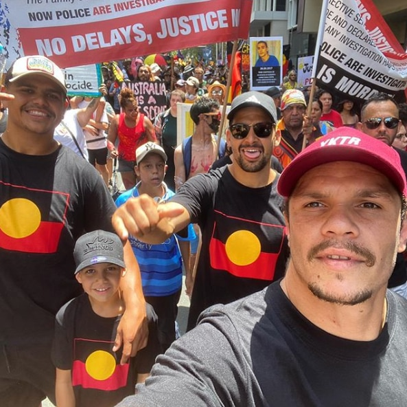 South Sydney NRL players are marching as part of the Invasion Day Rally on Gadigal land in Sydney.