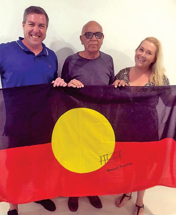 Founders of WAM Clothing Ben Wooster and Semele Moore with Aboriginal Flag designer Harold Thomas.