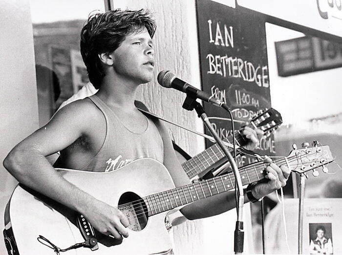 A young Troy Cassar-Daley busks in Tamworth