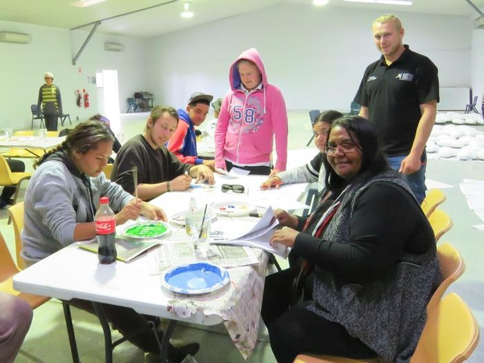 Students at Walgett Community College work on their quilt squares.