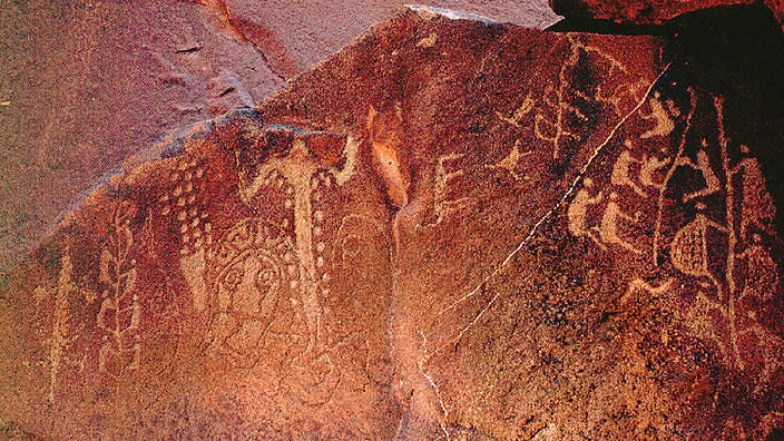 'Climbing Men Panel' found amongst thousands of drawings and carvings near the Burrup Peninsula in Western Australia. Federal Environment Minister Ian Campbell