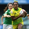 Mahalia Murphy of Australia is tackled by Amee Leigh Murphy Crowe of Ireland during the Women's Pool match of the Sydney Rugby 7s Series in Sydney, Friday, Feb. 3, 2017. (AAP Image/Dan Himbrechts) NO ARCHIVING