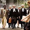 Eddie Mabo walking with his team of lawyers in the case which the High Court announced its historic decision, overturning the legal doctrine of terra nullius.