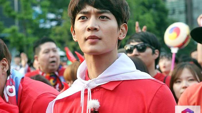 SHINee's Minho watches pensively...