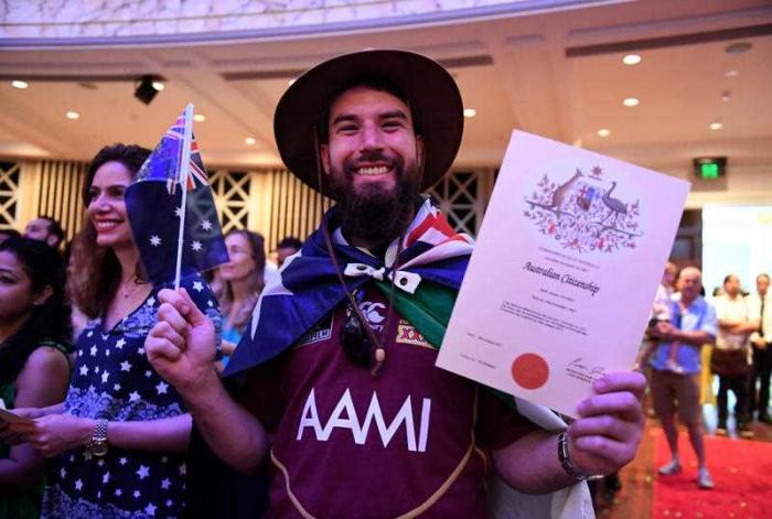 Mark Alcorn of Ireland celebrates receiving his Australian citizenship at a citizenship ceremony on Australia Day in Brisbane, Thursday, Jan. 26, 2017.