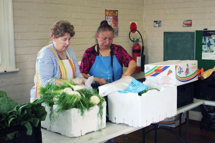 Volunteers prepare food for disadvantaged people