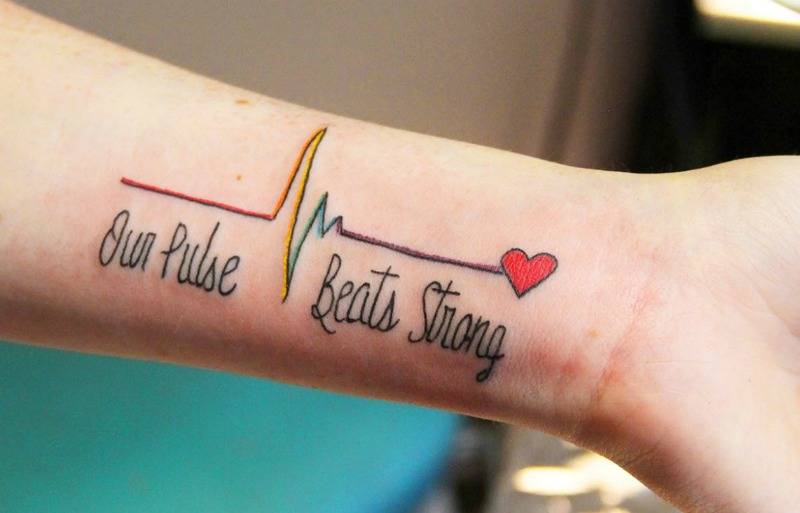 0120a3bdf Hundreds of people are getting Pulse tattoos in the wake of the Orlando  massacre Mourners make a permanent tribute to the lives that were lost....  ...