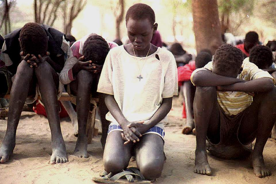"""Children at the Kakuma refugee camp in 1992. Displaced by civil war, international aid agencies call them the """"lost generation""""."""