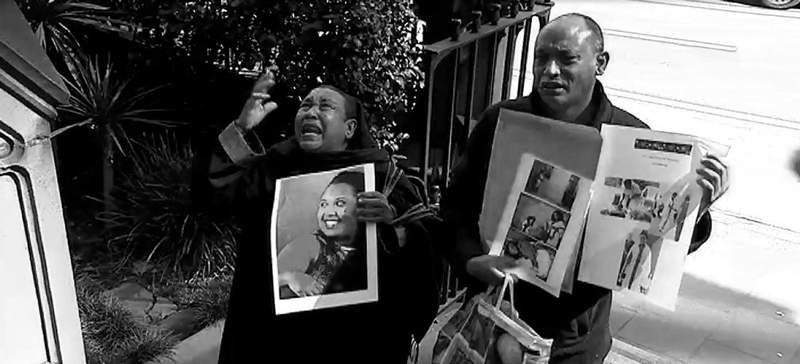 Eshete and Tsegaye outside the Supreme Court of NSW. (AAP Image\/Joel Carrett)