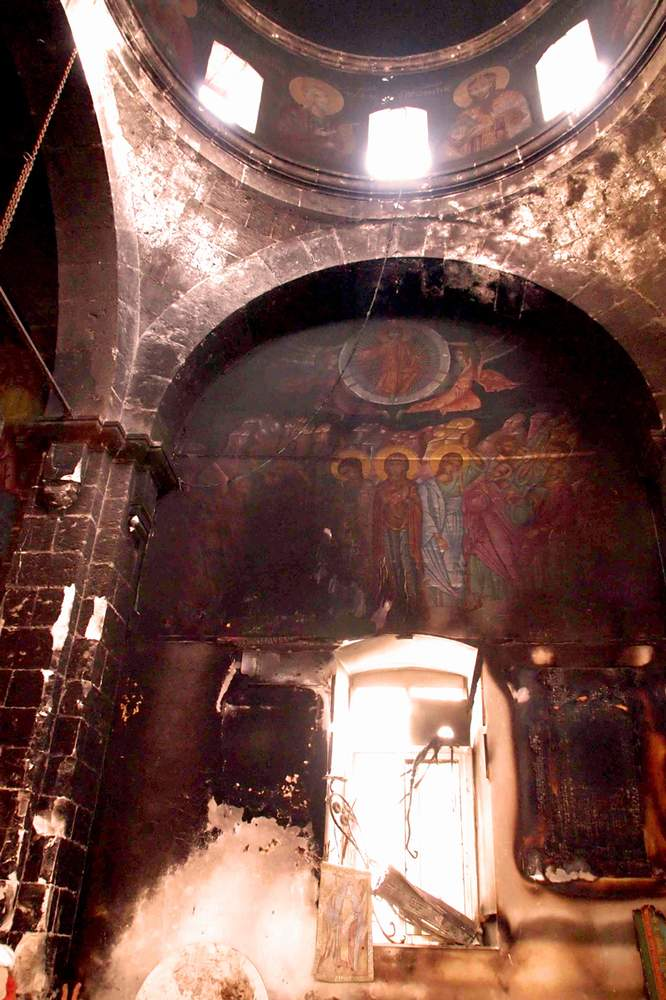 A burnt-out church in Maloula, Syria.