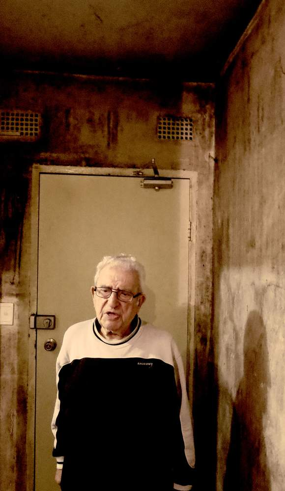 Theo, 87, in his mouldy apartment.