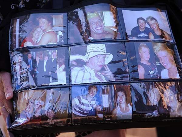 A bag covered in pictures of Matthew Leveson carried by Faye Leveson in October 2009.(AAP Image\/Dean Lewins)