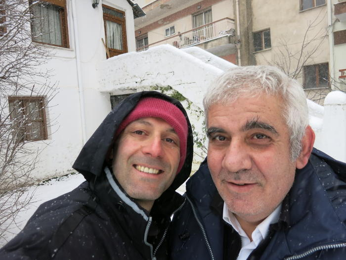 Papathanasiou (left) with his brother Billy, shovelling snow in front of their mountain home in northern Greece.