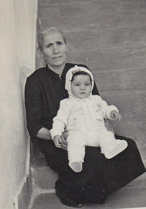 Papathanasiou's biological brother Billy as a baby, pictured with his yiayia.