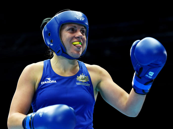 Australia's Shelley Watts (blue) during the women's  lightweight (60kg) boxing semi final at the XX Commonwealth Games, SECC, Glasgow, Scotland, Friday, Aug. 1, 2014. (AAP Image/Tracey Nearmy) NO ARCHIVING, EDITORIAL USE ONLY
