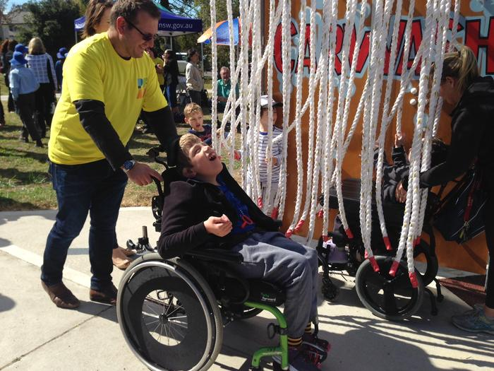 Tim Smith and his son Marcus at the new inclusive playground in Belrose, Sydney.