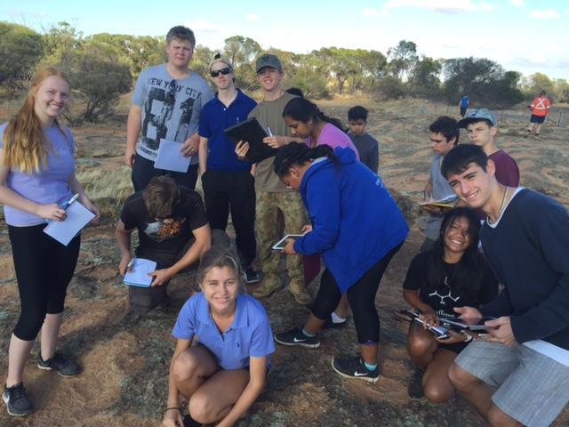 urbaniak and students posing to camera on a fieldtrip