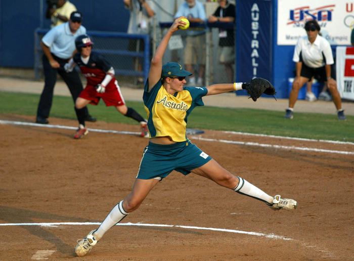 Australia pitcher Jocelyn McCallum throw in relief against the United States at the World Cup of Softball in Oklahoma City, Friday, July 15, 2005. United States' Kelly Kretschman is on first base.  (AP Photo/Sue Ogrocki)