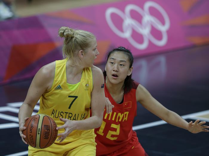 China's ' Gao Song, right, tries to block Australia's Abby Bishop, left, during their women's quarterfinal basketball game at the 2012 Summer Olympics, Tuesday, Aug. 7, 2012, in London. (AP Photo//Lefteris Pitarakis)
