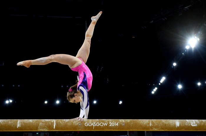 Australia's Lauren Mitchell competes on the Beam during the Women's Gymnastics Artistic Apparatus final in The SSE Hydro for the XX Commonwealth Games, Glasgow, Scotland, Friday, Aug. 1, 2014. (AAP Image/Tracey Nearmy) NO ARCHIVING, EDITORIAL USE ONLY